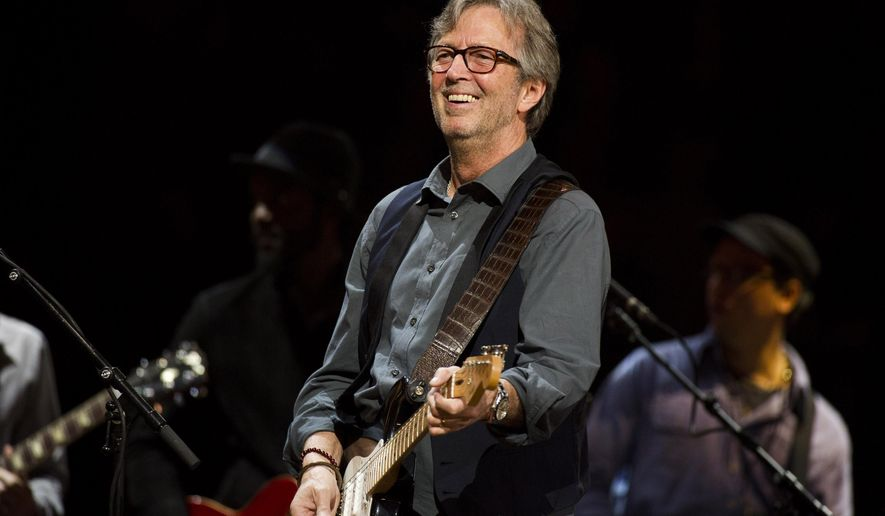 FILE - In this April 14, 2013 file photo, Eric Clapton performs at Eric Clapton's Crossroads Guitar Festival 2013 at Madison Square Garden in New York. Clapton announced Thursday  March 12, 2015, that he will celebrate his 70th birthday with two shows at Madison Square Garden on May 1-2. He turns 70 on March 30. (Photo by Charles Sykes/Invision/AP, File)