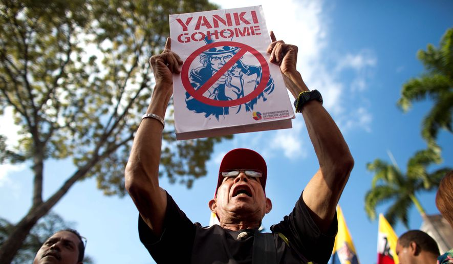Sending a message: Venezuelans rallied for their government Thursday as President Nicolas Maduro responded to U.S. sanctions by asking legislators to expand his powers in the name of fighting imperialism. (Associated Press)