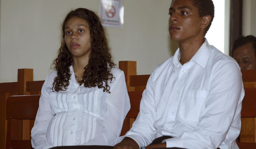 Heather Mack, left, and her boyfriend Tommy Schaefer, both from Chicago, Ill., sit at a court room to witness a trial in Bali, Indonesia Thursday, March 12, 2015. Mack, 19, charged with premeditated murder in the death of her mother on Indonesia's Bali island told a court Wednesday that her boyfriend killed her mother in anger after she threatened to kill their unborn baby. (AP Photo/Firdia Lisnawati)