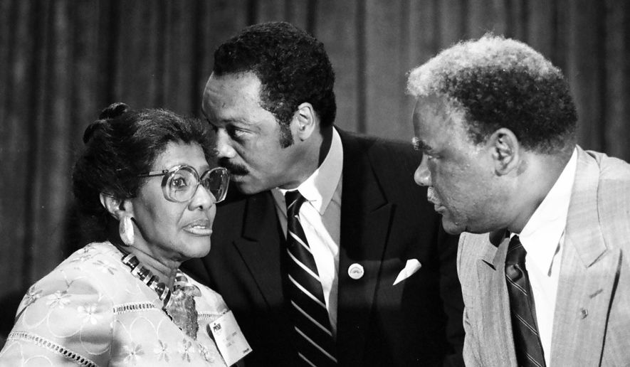 In this Aug. 3, 1986 photo, the Rev. Willie T. Barrow, left, confers with Jesse Jackson Jr., center, and Chicago Mayor Harold Washington during the Operation Push convention in Chicago. Barrow, a longtime civil right activist, died Thursday, March 12, 2015, at a hospital where she was being treated for a blood clot in her lung. She was 90. (AP Photo/Sun-Times Media)  CHICAGO TRIBUNE OUT, MANDATORY CREDIT, MAGS OUT, NO SALES