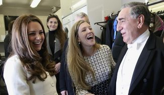 "Britain's Kate, duchess of Cambridge, left, chats with actor Jim Carter, who portrays the butler Carson, during an official visit to the set of the TV series ""Downton Abbey"" at Ealing Studios in London Thursday, March 12, 2015. (AP Photo/Chris Jackson, Pool)"