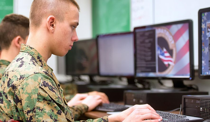 In this photo taken March 10, 2015, George Zenner, team captain of the Marine Military Academy CyberPatriot team, practices his security skills before the competition this week in Harlingen, Texas.  (AP Photo/Valley Morning Star, David Pike)