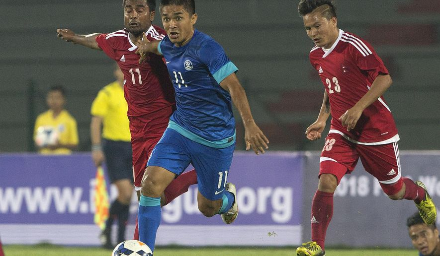 Indian vice captain, Sunil Chhetri, center in blue, advances with the ball during their 2018 World Cup qualifying match against Nepal in Gauhati, India, Thursday, March 12, 2015. Chhetri scored two goals to beat Nepal 2-0. (AP Photo/ Anupam Nath)