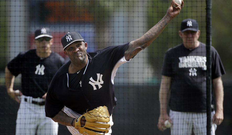 New York Yankees manager Joe Girardi, left, and pitching coach Larry Rothschild, right, watch as starting pitcher CC Sabathia throws off a mound to hitters during a simulated game at spring training baseball, Thursday, March 12, 2015, in Tampa, Fla. Sabathia is coming back from an injury-shortened 2014 season in which he had knee surgery. (AP Photo/Kathy Willens)