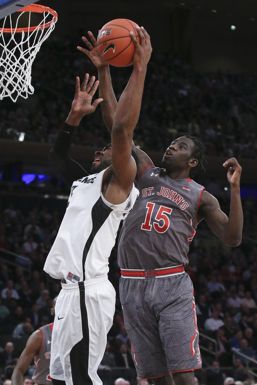 Providence forward LaDontae Henton, left, shoots against St. John's guard Sir'Dominic Pointer (15) in the first half of an NCAA college basketball game in the quarterfinals of the Big East Conference tournament, Thursday, March 12, 2015, in New York. (AP Photo/John Minchillo)