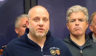 Noel DiGerolamo, left, President of the Suffolk County Police Benevolent Association, and Suffolk County Executive Steven Bellone, speak with reporters at a news conference at Stony Brook University Hospital, Thursday, March 12, 2015 in Stony Brook, N.Y. A Suffolk County police officer was shot and wounded while confronting a suspect who fled a traffic stop, police officials said. (AP Photo/Mike Balsamo)