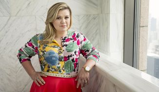 "American singer and songwriter Kelly Clarkson poses for a portrait in promotion of her forthcoming album ""Piece by Piece"" at the Sony Club, on Wednesday, March 4, 2015 in New York. (Photo by Victoria Will/Invision/AP)"