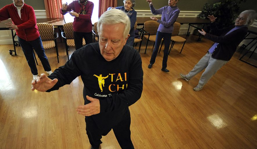 ADVANCE FOR SUNDAY MARCH 14 AND THEREAFTER - In a Feb. 18, 2015 photo, YMCA Tai Chi instructor Jerry Galas leads a class to increase balance and posture in the hopes of decreasing the occurrences of falls and injuries related to them at Felician Village in Manitowoc. (AP Photo/Herald Times Reporter, Matthew Apgar)