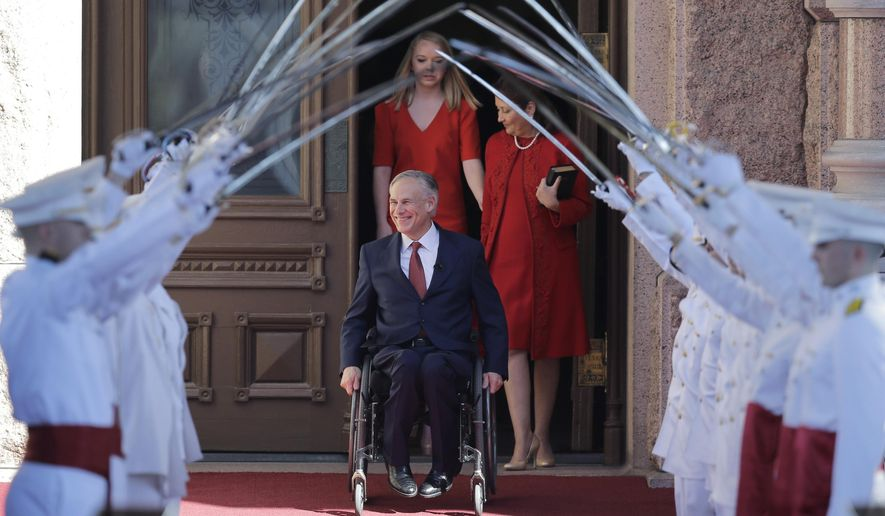 In this Jan. 20, 2015, file photo, incoming Gov. Greg Abbott, center, arrives for his inauguration with his wife, Cecilia, right, and daughter, Audrey, left, in Austin, Texas. Abbott, Texas' first governor in a wheelchair, says the visibility of his position alone is an asset to the disabled, and he believes they will benefit from his economic agenda, along with the rest of the state.  (AP Photo/Eric Gay)