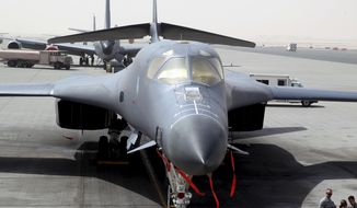 In this photo taken Monday, March 9, 2015, a B-1 bomber is seen at the al-Udeid Air Base in Doha, Qatar. The base is the regional nerve center for the air war against the militants who have taken over nearly a third of Iraq and Syria. That makes it the main hub for coordinating warplanes from the U.S. and 11 other nations in the coalition carrying out bombing raids. (AP Photo/Osama Faisal)