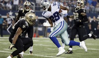 FILE - In this Sept. 28, 2014, file photo, Dallas Cowboys' DeMarco Murray (29) sprints to the end zone for a touchdown as New Orleans Saints' Jairus Byrd, left, attempts to stop him during the second half of an NFL football game in Arlington, Texas. The Saints' Kenny Vaccaro (32) and Corey White (24) watch on the play. NFL free agency begins Tuesday, March 10, 2015.  (AP Photo/Brandon Wade, File)
