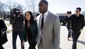 Running back DeMarco Murray arrives with his fiancee Heidi Mueller at the Philadelphia Eagles' NFL football practice facility, Thursday, March 12, 2015, in Philadelphia. (AP Photo/Matt Slocum)