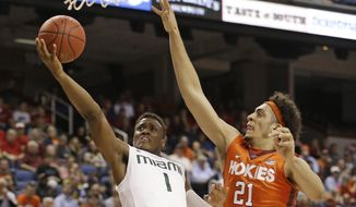 Miami's Deandre Burnett (1) drives past Virginia Tech's Satchel Pierce (21) during the first half of an NCAA college basketball game in the second round of the Atlantic Coast Conference tournament in Greensboro, N.C., Wednesday, March 11, 2015. (AP Photo/Bob Leverone)