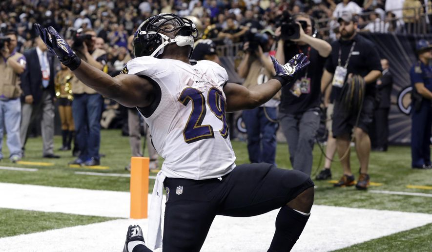 FILE - In this Nov. 24, 2014, file photo, Baltimore Ravens running back Justin Forsett (29) celebrates his touchdown run in the second half of an NFL football game against the New Orleans Saints in New Orleans. Forsett agreed to terms Thursday, March 12, 2014, on a three-year contract with the Ravens, who keep their leading rusher from 2014 after losing several key free agents earlier in the week. (AP Photo/Jonathan Bachman, File)