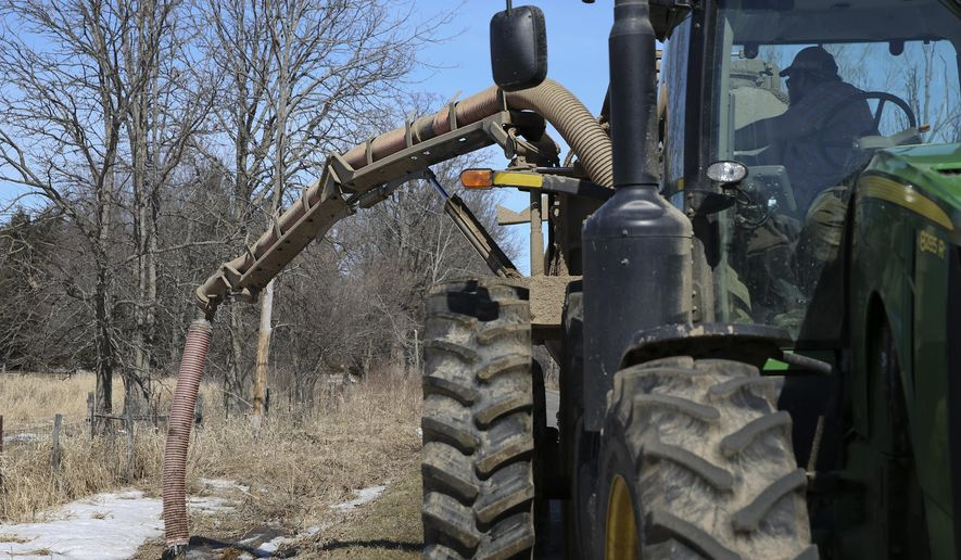 Manure-tainted water is being pumped out of the area that threatens to run off into Bear Creek and surrounding wetlands in Wakeshma Township, Mich., on Thursday March 12, 2015. (AP Photo/Kalamazoo Gazette, Crystal Vander Weit) ** FILE **