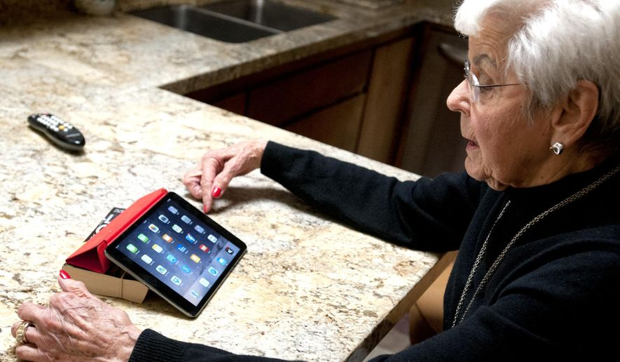 In this Feb. 18, 2015 photo, Dorie Thorpe talks about her use of technology during an interview at her Logan, Utah home. Thorpe's activities are part of a larger trend of more seniors using technology. According to the Pew Research Center, six out of 10 seniors (those age 65 and over) go online. (AP Photo/Herald Journal, John Zsiray)