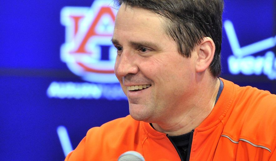Auburn defensive coordinator Will Muschamp talks with the media after spring football practice Thursday, March 12, 2015, in Auburn, Ala. (AP Photo/AL.com, Julie Bennett)