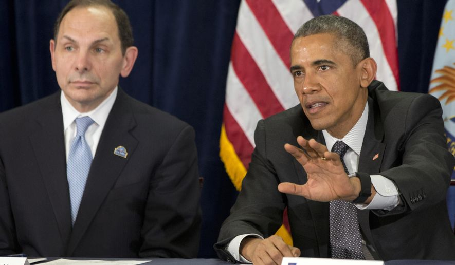 President Barack Obama speaks next to new VA Secretary Robert McDonald during a meeting on veterans issues at the Phoenix VA Medical Center on March 13, 2015. (Associated Press) **FILE**