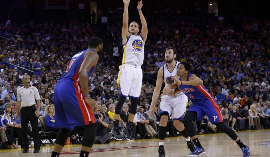 Golden State Warriors' Stephen Curry (30) shoots against the Detroit Pistons during the second half of an NBA basketball game Wednesday, March 11, 2015, in Oakland, Calif. Golden State won 105-98. (AP Photo/Marcio Jose Sanchez)