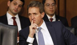 Sen. Jeff Flake, R-Ariz., listens during a Senate Judiciary Committee hearing on Capitol Hill in Washington in this Jan. 28, 2015, file photo. (AP Photo/Jacquelyn Martin) ** FILE **