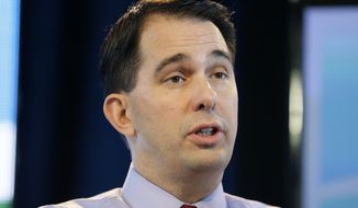 FILE - In this March 7, 2015, file photo, Wisconsin Gov. Scott Walker speaks during the Iowa Agriculture Summit in Des Moines, Iowa. Pegging him as rising opponent in the Republican race for president, rivals of Walker have identified his changing positions on several issues as a potent line of criticism. (AP Photo/Charlie Neibergall, File)