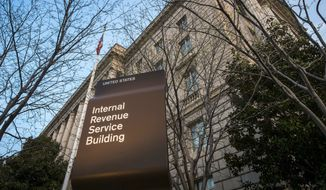 The Internal Revenue Service Headquarters (IRS) building is seen in Washington on April 13, 2014. Unscrupulous tax preparers are using President Obama's health care law as a ploy to pocket bogus fines from unsuspecting taxpayers, including some immigrants not bound by the law's requirements, the IRS warned March 13, 2015. (Associated Press)