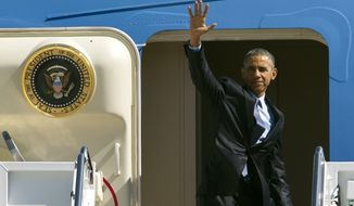 President Obama waves from Air Force One before departing Andrews Air Force Base, Md., en route to Los Angeles on March 12, 2015. (Associated Press) **FILE**