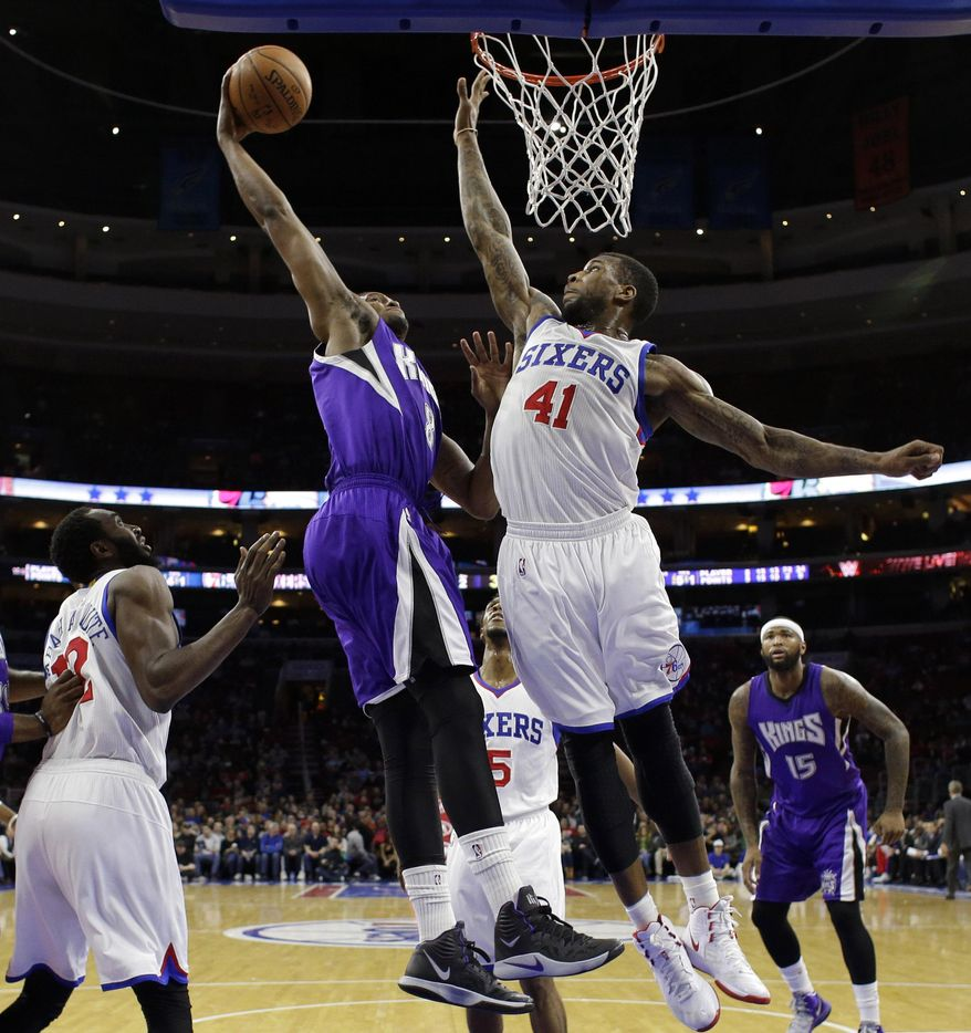 Sacramento Kings' Rudy Gay (8) goes up for a dunk against Philadelphia 76ers' Thomas Robinson (41) during the first half of an NBA basketball game, Friday, March 13, 2015, in Philadelphia. (AP Photo/Matt Slocum)