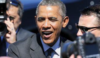 President Barack Obama arrives at Sky Harbor International Airport, Friday, March 13, 2015, in Phoenix. (AP Photo/Matt York) ** FILE **