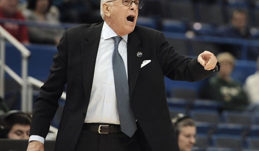 SMU head coach Larry Brown calls out to his team during the first half of an NCAA college basketball game against East Carolina in the quarterfinals of the American Athletic Conference tournament, Friday, March 13, 2015, in Hartford, Conn.  (AP Photo/Jessica Hill)