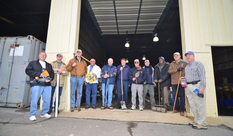 A  group of men  know as the Kingsport Regulars pose outside there storage building in Kingsport, Tenn, March 20, 2013. The get together and help build houses for low-income families L to R: Jim Boushley, Doyle Alley, John Peters, Geoff Dougal, Charles Barrett, Gordon Travis, Dick Orr, J.J., John Harrison, Chuck Smith and Al Miller . (AP Photo/Kingsport Times News, David Grace)