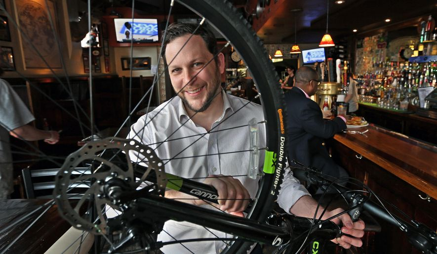 Jake Crocker plans on 'biking-out' his restaurant, F.W. Sullivan's, with bikes and cycling decorations in preparation for the UCI Road World Championships in September. His restaurant is at 2401 W. Main Street in Richmond, Va., March 11, 2015. (AP Photo/Richmond Times-Dispatch, P. Kevin Morley)