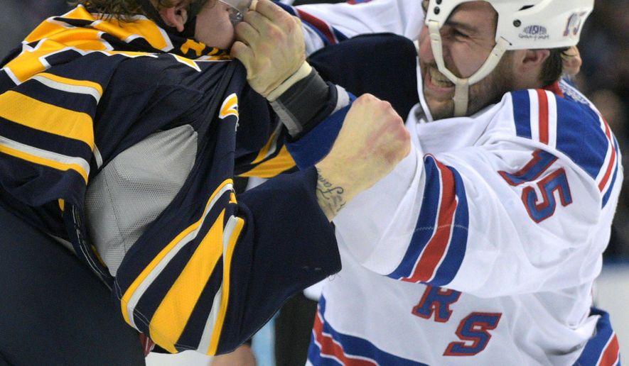 New York Rangers left wing Tanner Glass (15) punches Buffalo Sabres left wing Nicolas Deslauriers (44) during the second period of an NHL hockey game Saturday, March 14, 2015, in Buffalo, N.Y. (AP Photo/Gary Wiepert)