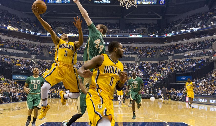 Indiana Pacers guard George Hill (3) shoots as Boston Celtics center Tyler Zeller (44) defends during the first half of an NBA basketball game, Saturday, March 14, 2015, in Indianapolis. (AP Photo/Doug McSchooler)