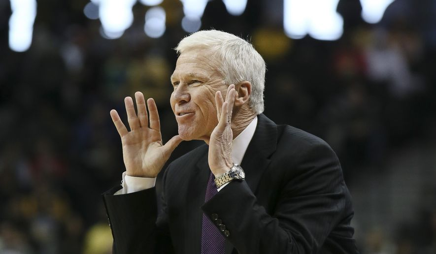 Davidson head coach Bob McKillop directs his players from the bench in the first half of an NCAA college basketball game against VCU in the semifinals of the Atlantic 10 Conference tournament in New York, Saturday, March 14, 2015. (AP Photo/John Minchillo)