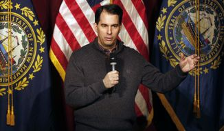 Wisconsin Gov. Scott Walker speaks at a training workshop for the New Hampshire state Republican Party in the auditorium at Concord High School Saturday, March 14, 2015, in Concord, N.H. (AP Photo/Jim Cole)