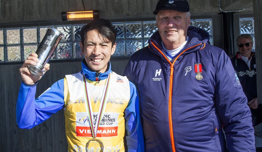 Akito Watabe, Japan, left,  poses with King Harald of Norway after winning the final World Cup Nordic Combined event of the season in the Holmenkollen Ski Arena in Oslo Saturday March 14, 2015.(AP Photo/Jon Olav Nesvold / NTB scanpix) NORWAY OUT