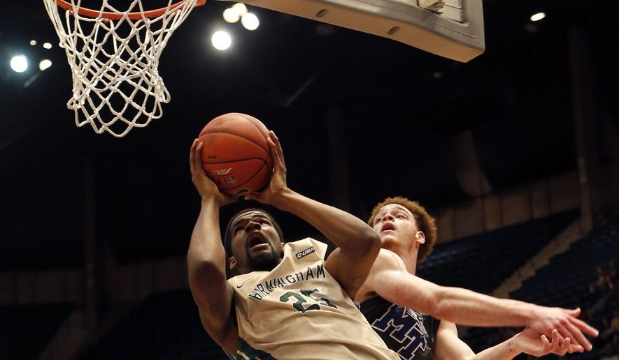 UAB Blazers forward C.J. Washington (25) shoots around Middle Tennessee Blue Raiders forward Reggie Upshaw Jr. (30) during the first half of an NCAA college basketball game in the Conference USA tournament championship, Saturday, March 14, 2015, in Birmingham, Ala. (AP Photo/Butch Dill)