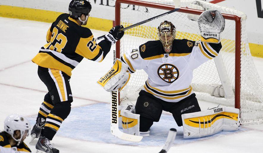 Pittsburgh Penguins' Steve Downie (23) works in front of Boston Bruins goalie Tuukka Rask (40) during the first period of an NHL hockey game in Pittsburgh Saturday, March 14, 2015.(AP Photo/Gene J. Puskar