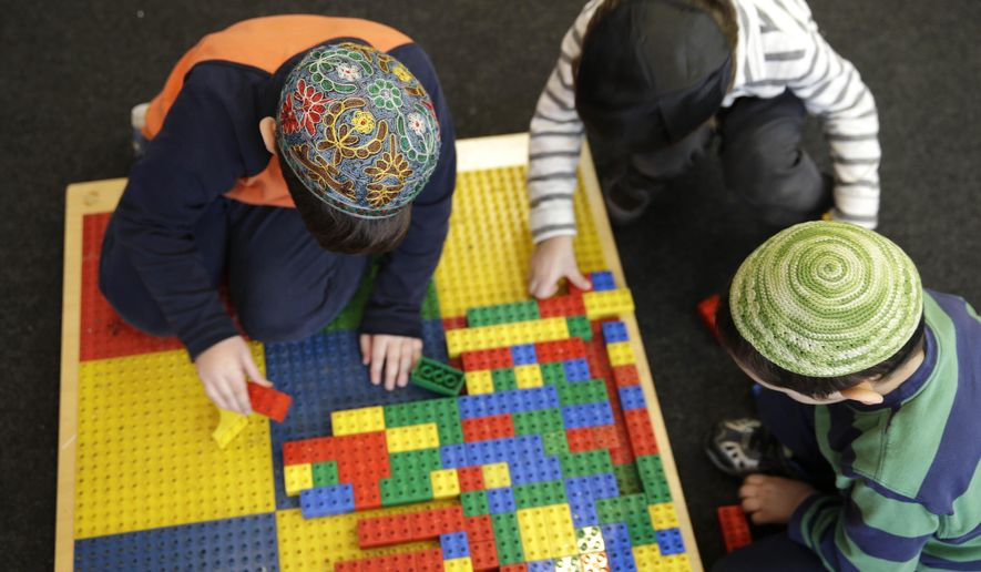 Jewish children wear skull caps, or kippah, in their pre-kindergarten class at the Al & Sonny Gindi Barkai Yeshivah in Brooklyn, New York, on March 11, 2015. (Associated Press) **FILE**