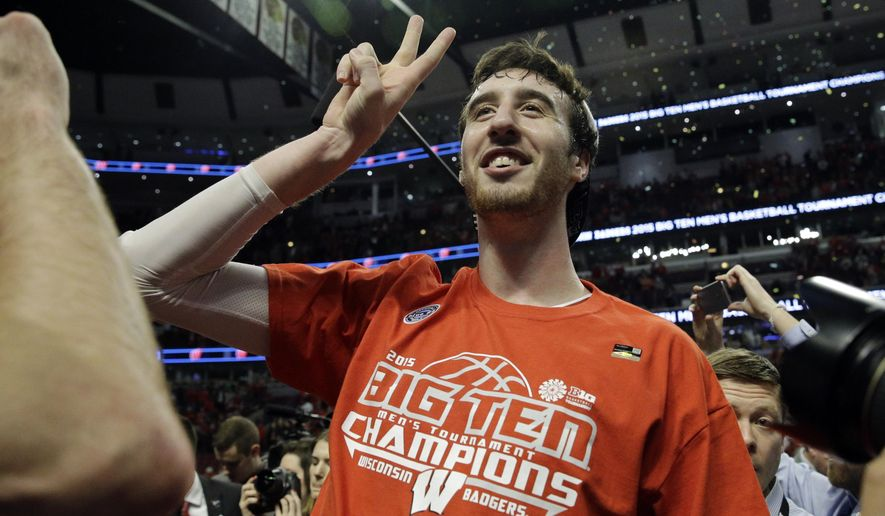 Wisconsin's Frank Kaminsky celebrates following an NCAA college basketball game against Michigan State in the championship of the Big Ten Conference tournament in Chicago, Sunday, March 15, 2015. Wisconsin defeated Michigan State 80-69 in overtime. (AP Photo/Nam Y. Huh)