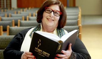 In this March 12, 2015 photo, Rabbi Denise Eger poses at Congregation Kol Ami, a Reform synagogue with gay and lesbian outreach programs, in West Hollywood, Calif. As a rabbinic student in 1980s New York City, Eger quietly started a group for fellow gay and lesbian students. The Reform Jewish movement has traveled a long road toward recognizing and embracing same-sex relationships. That journey has led this week to Philadelphia, where Ms. Eger will be installed Monday, March 16, 2015 as the first openly gay president of the Central Conference of American Rabbis, the rabbinical arm of Reform Judaism. (AP Photo/Nick Ut)