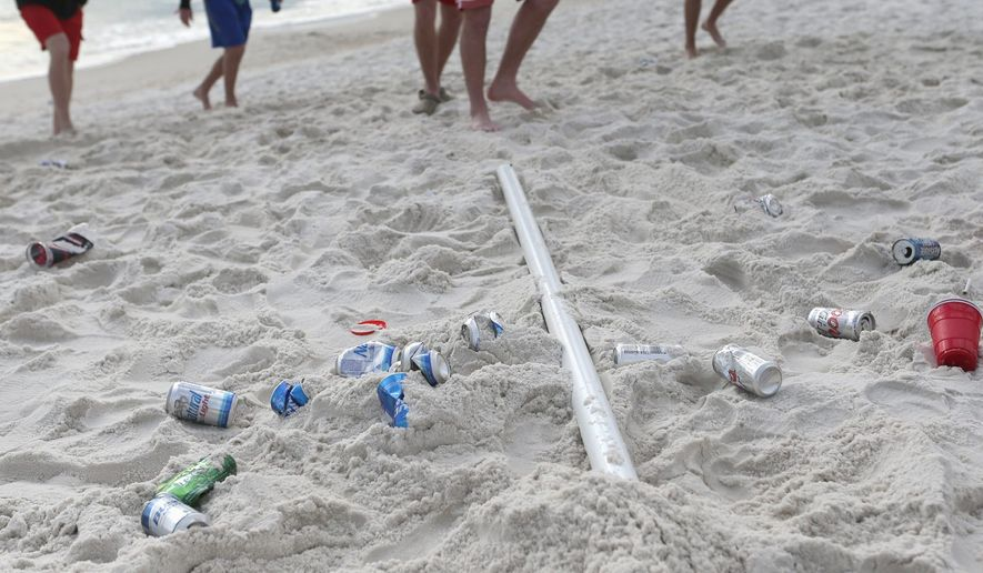 Trash begins to fill the sandy white beaches during the first week of spring break this month in Panama City Beach, Florida. (Associated Press)