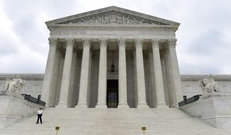 The Supreme Court is seen in Washington in this Oct. 3, 2014, file photo. (AP Photo/Susan Walsh, File)