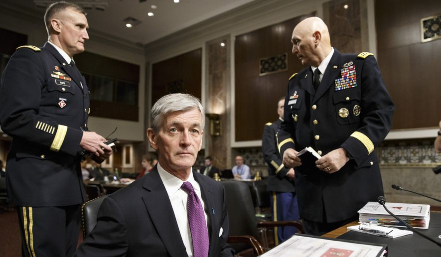 Secretary of the Army John M. McHugh, flanked by Army Chief of Staff Gen Raymond Odierno, right, and Maj. Gen. William E. Rapp, the Army legislative liaison, arrives to update members of the Senate Armed Services Committee about the deadly shooting rampage by a soldier yesterday at Fort Hood in Texas, on Capitol Hill in Washington, Thursday, April 3, 2014. An Iraq War veteran being treated for mental illness was the gunman who opened fire at Fort Hood, killing three people and wounding 16 others before committing suicide, in an attack on the same Texas military base where more than a dozen people were slain in 2009.   (AP Photo/J. Scott Applewhite)