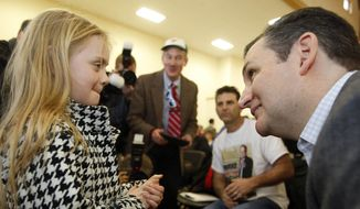 U.S. Sen. Ted Cruz, R-Texas, a tea party favorite and possible presidential candidate in 2016, speaks to Baily Ealy during a Strafford County Republican Committee Chili and Chat on Sunday, March 15, 2015, in Barrington, N.H. (AP Photo/Jim Cole) ** FILE **
