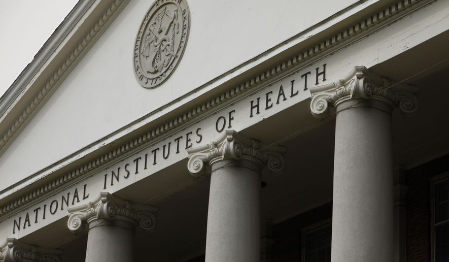 The main building of the National Institutes of Health is seen in Bethesda, Md., in this Aug. 17, 2009 file photo. . (AP Photo/J. Scott Applewhite, File) **FILE**