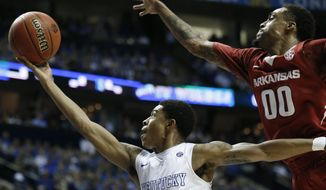 Kentucky guard Tyler Ulis (3) shoots against Arkansas guard Rashad Madden (00) during the second half of the NCAA college basketball Southeastern Conference tournament championship game, Sunday, March 15, 2015, in Nashville, Tenn. (AP Photo/Steve Helber)