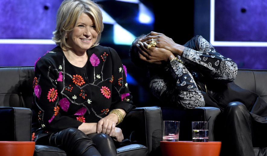 Martha Stewart, left, and Snoop Dogg appear on stage at the Comedy Central Roast of Justin Bieber at Sony Pictures Studios on Saturday, March 14, 2015, in Culver City, Calif. (Photo by Chris Pizzello/Invision/AP)