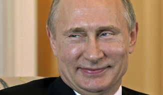 Russian President Vladimir Putin smiles during his meeting in the Konstantin Palace outside St. Petersburg, Russia, March 16, 2015. (Associated Press) ** FILE **